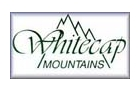 [Whitecap Mountains Logo]